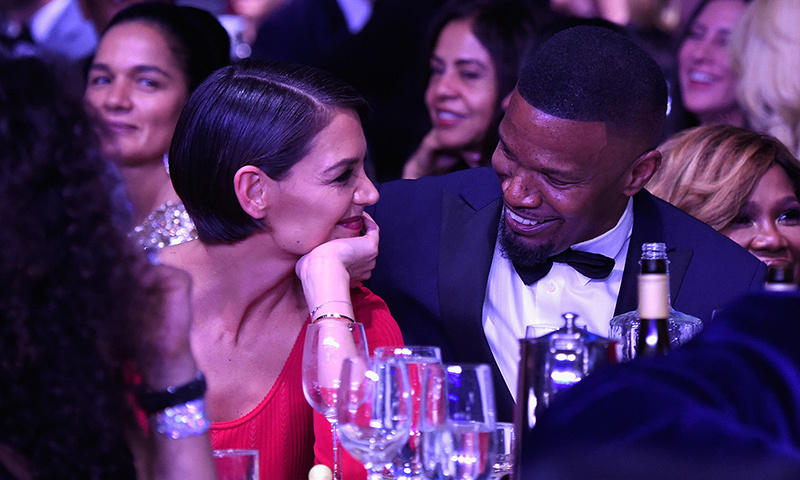 Reports have long been swirling that Katie Holmes and Jamie Foxx are together, but the couple's romance was finally on full display at Clive Davis's GRAMMY bash. The couple looked cozy and shared lots of laughs at the star-studded party.