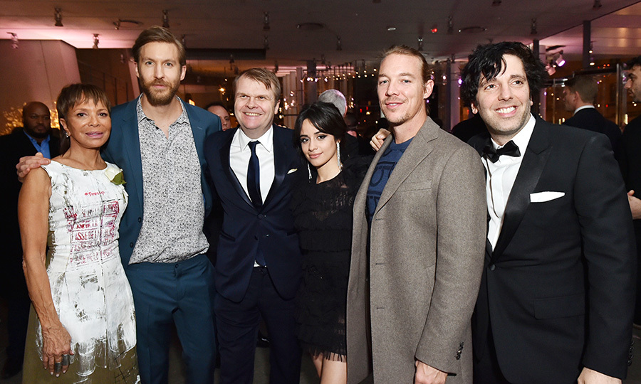 Ex-Fifth Harmony member Camila Cabello posed alongside the industry's most famous faces, like Epic Records president Sylvia Rhone, DJ Calvin Harris, Sony Music Entertainment CEO Rob Stringer, DJ Diplo, and the chairman and CEO of Columbia Ron Perry. The crew was attending the Sony Music Entertainment post-GRAMMY reception.