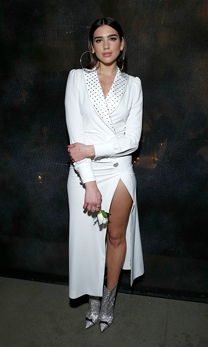 Musician Dua Lipa looked super chic in a high-light white dress and metallic boots at the Universal after party.