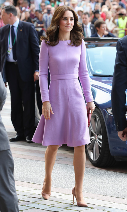To mark the final day of her royal tour in Poland and Germany, the Duchess of Cambridge looked lovely in a bespoke lilac midi dress by Emilia Wickstead. The fashion-forward number featured a skater skirt and long sleeves and was teamed with a pair of nude court shoes. To accessorize, Kate chose a bold red clutch.