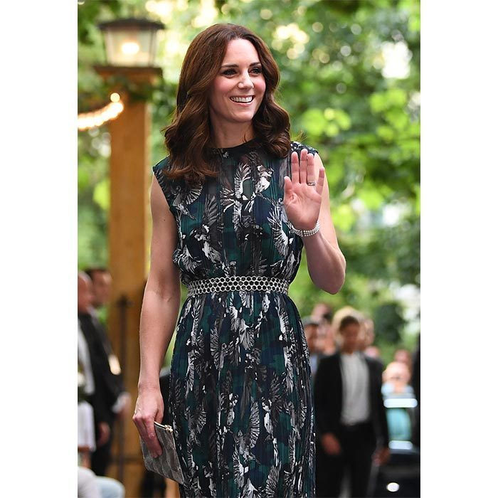For a visit to Clärchens Ballhaus, Kate celebrated Germany's local fashion scene in a sleeveless green and black dress by designer Markus Lupfer. She accessorized the sweet frock, which features an elegant bird print, with a silver clutch and Prada shoes.