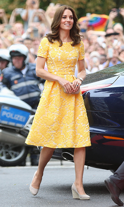 The Duchess of Cambridge continued her colourful style streak as she stepped out for the fourth day of the royal tour in Heidelberg on July 20. Kate turned heads in a sunflower yellow lace fit and flare dress from Jenny Packham – one of her fave designers – as she joined her husband Prince William at the German Cancer Research Centre.