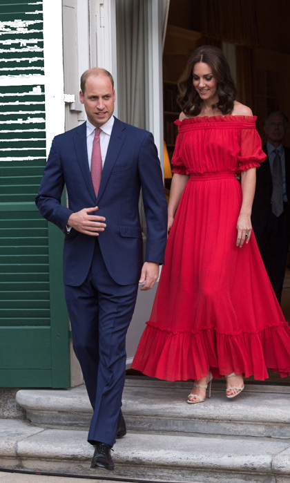 For a birthday party celebrating the Queen, Kate slipped into a red Alexander McQueen dress with off-the shoulder sleeves in Berlin.
