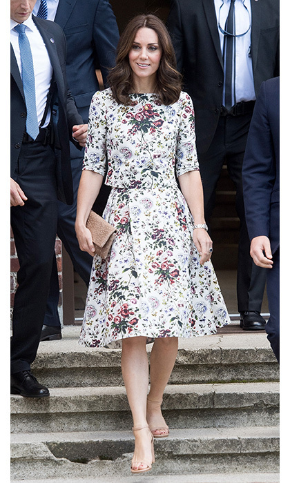 Kate started the second day of her visit to Poland in a floral two-piece ensemble by her go-to Canadian designer Erdem. She paired the skirt and top combo with a pair of nude sandals and matching clutch.