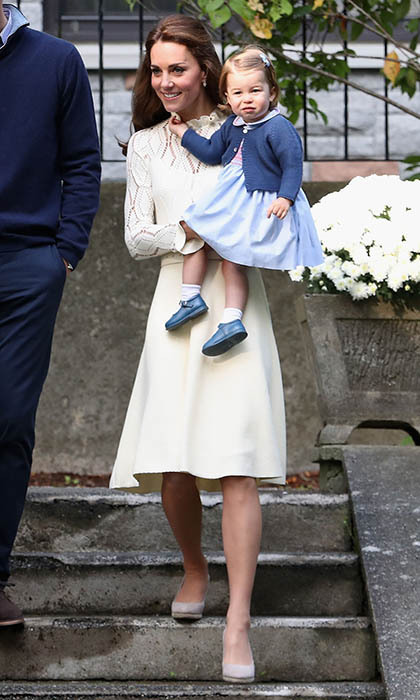 Kate arrived to a special children's party at Government House in a lace creation by See by Chloé. The cream dress features zigzag detailing and a slight pleat in the skirt. Kate customized the original design by adding a belt to cinch in the waist. 