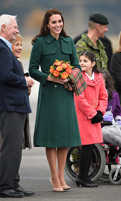 Kate swapped her green Dolce & Gabbana dress for an old favourite - this Hobbs trench-style coat, which was perfect for keeping the chill at bay when she arrived in Canada's Yukon. She also carried a beautiful maple leaf tartan scarf on her arm. 