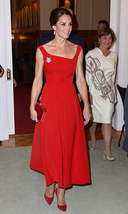 After a casual day in Bella Bella, Kate turned up the glamour in a dazzling red Preen gown for a glitzy dinner at Government House. She paired the gown with suede pumps, a Miu Miu clutch, Soru Jewellery's baroque pearl earrings and the Queen's historic diamond maple leaf brooch.