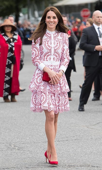 Kate greeted crowds in Vancouver wearing a custom red and white broderie anglaise Alexander McQueen dress. She further paid tribute to Canada's flag with matching red pumps and a small Miu Miu clutch.
