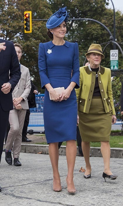 The Duchess of Cambridge arrived in Canada wearing one of her favourite designers - Jenny Packham. Kate paired her royal blue dress with a matching maple leaf-adorned Lock & Co hat, tanzanite earrings, nude Gianvito Rossi pumps, LK Bennett clutch and the Queen's stunning diamond maple leaf brooch.