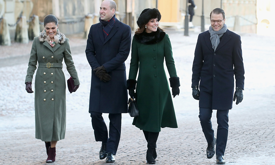 The royal quad - that's Crown Princess Victoria and Prince Daniel with the Cambridges - strolled the streets of Stockholm to visit Stortorget, the oldest square in the city, and the Nobel Museum. Kate stunned in a green, fur-lined Catherine Walker coat and a cute Mulberry bag. If you think her hat is familiar, you're not wrong - she wore it on Christmas Day at Sandringham! 