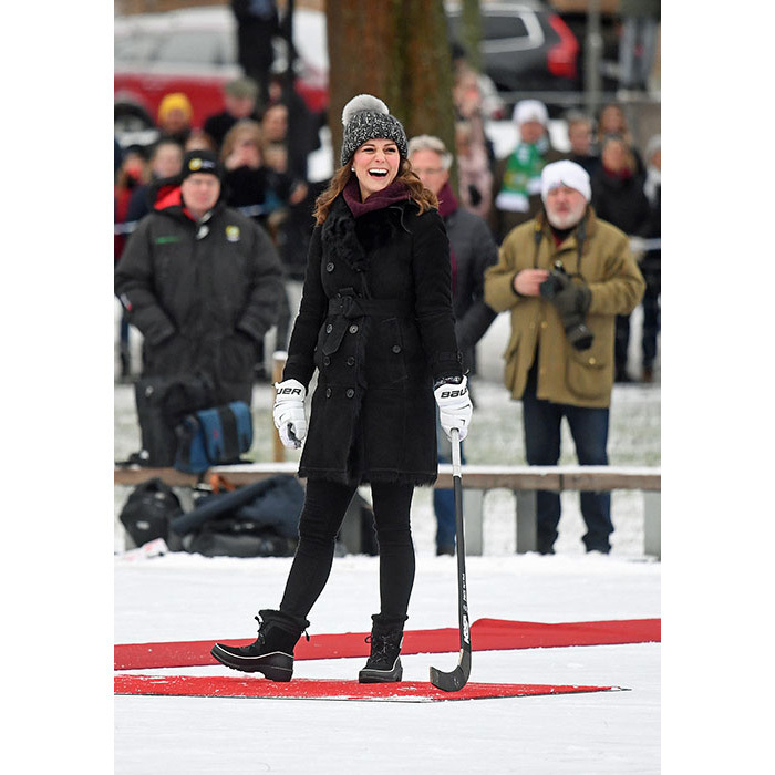 Kate was all smiles while getting sporty with her husband, Prince William. For a quick game of hockey, the mom of two donned a black Burberry coat, a cute bobble hat by Eugenia Kim and a sweater by Fjallraven. She kept her feet dry in a $180 pair of Sorel boots and faux-fur gloves.