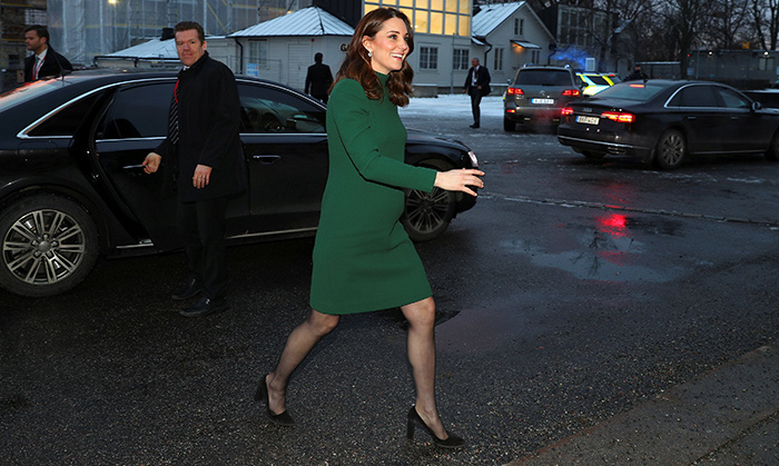 The Duchess stunned in a green high-neck Catherine Walker dress for a luncheon at the Royal Palace of Stockholm. Kate accessorized with simple black heels, a neutral makeup look and kept her hair in beautiful loose waves.
