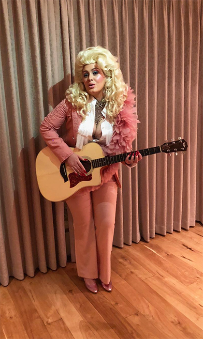 "Adele took to Instagram on Jan. 29 to share her love for legendary country singer Dolly Parton. The ""Hello"" singer donned Dolly's traditional pink ensemble, popping on her iconic blond hair. She captioned the image, ""The effortless queen of song, Dolly Parton! We love you! We wish We could possess an ounce of your ability. You were the hero of our night! A hero of my life. I'll always love you x"".