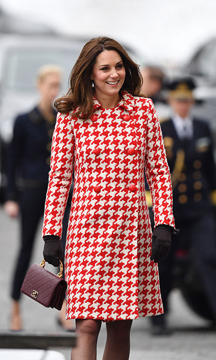 Kate, who is pregnant with her third child, opted for a striking red and white Catherine Walker coat. She styled the look further with a maroon Chanel bag and fringed leather pumps from Italian label Tod's. Her brunette tresses were preened to perfection in loose waves, while her pretty facial features were accentuated with muted tones of makeup.