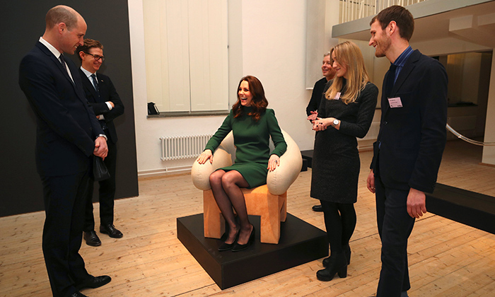 The Duchess had a laugh while trying out one of Sweden's iconic chairs at the ArkDes Museum during the 2018 royal tour of Scandinavia.