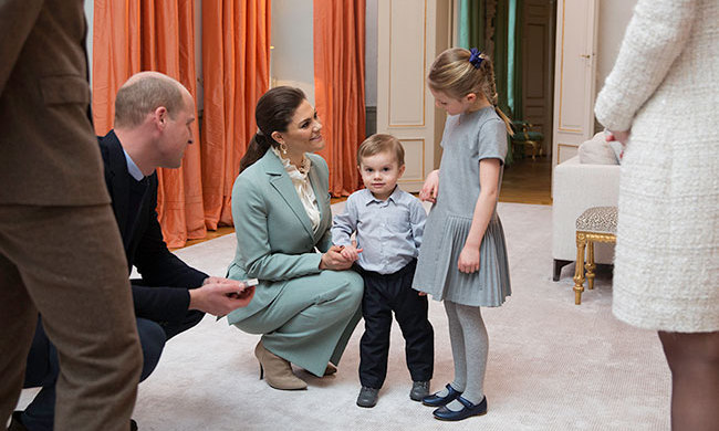 Princess Estelle looked down lovingly at her little brother Prince Oscar while visiting with Duchess Kate and Prince William.