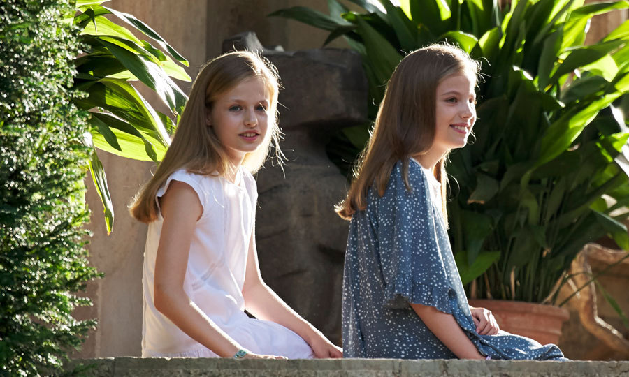 <p>The royal sister duo took a break from their family summer photocall together at Marivent Palace in Mallorca in July 2017. Princess Leonor wore a white lace dress while her sister Sofia complemented her in a three-quarter sleeved blue floral lace dress.</p>