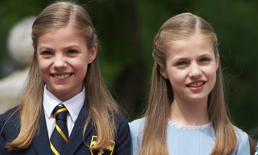<p>Princess Leonor and Infanta Sofia had identical hairstyles for Sofia's First Communion in May 2017. The older Princess wore her school uniform while Sofia was in a powder blue dress.</p>