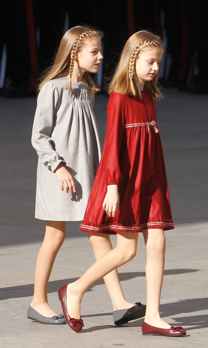 <p>The Spanish sisters stepped out for the opening ceremony donning fall-inspired frocks and matching braided hairstyles. </p>