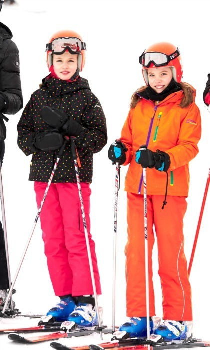 <p>Letizia and Felipe's girls added some style to the slopes during a private family ski break in February 2017. The duo wore matching orange helmets but added their individual pop of color to their sporty attire. </p>