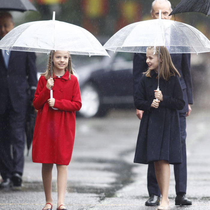 <p>The duo braved the rain in 2016 as they stepped out to attend a military parade on Spain's National Day in Madrid wearing Carolina Herrera coats and matching braids.</p>