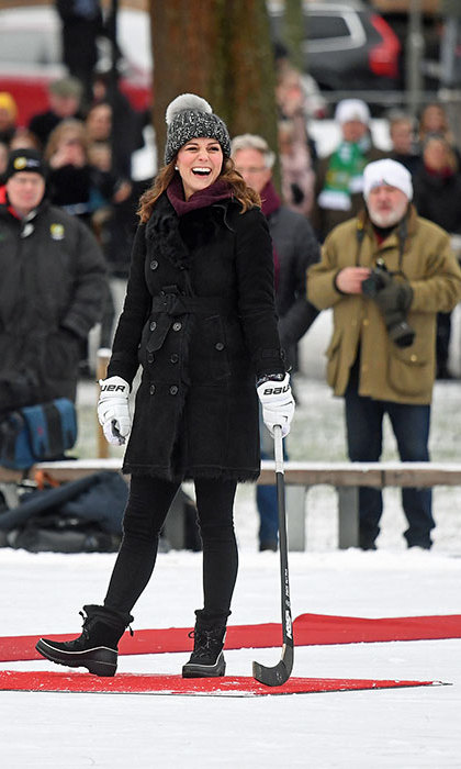 Kate was dressed for the cold weather in a warm black coat by Burberry, a jumper by Swedish designer Fjallraven, snow boots with matching grey gloves and a thick grey knitted bobble hat. The mum-of-two, who is currently expecting her third child, had a couple of attempts at scoring a goal, and the crowd of onlookers cheered when she succeeded on her second try. 