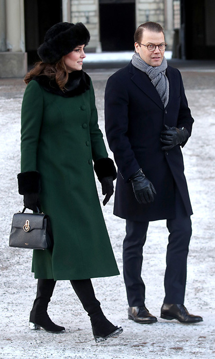 Kate strolled with Prince Daniel as they made their way from the Royal Palace of Stockholm to the Nobel Museum. Kate looked chic in a dark green coat with black fur cuffs. She accessorised the look with a black fur hat and matching gloves, and completed the look with a black Mulberry bag. 