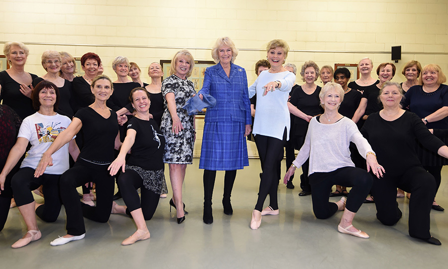 Camilla, Duchess of Cornwall, posed with Elaine Paige, Angela Rippon and dance students during a Feb. 1 visit students, staff and to learn about the Silver Swans program, an initiative which delivers ballet classes specially designed for over 55s.