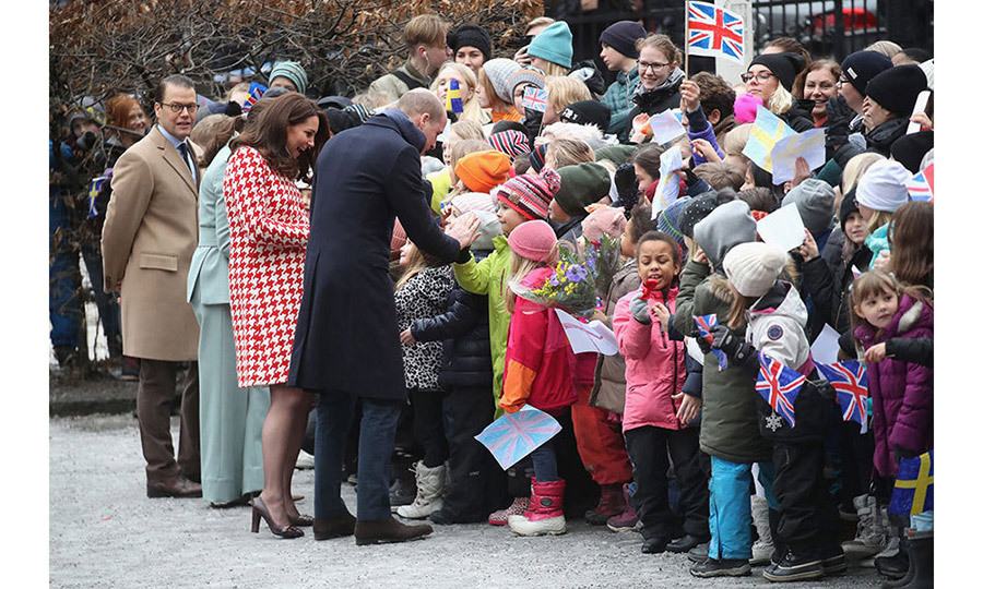 William and Kate looked delighted as they met with young children during their visit. The Prince was even seen giving one child a high five!