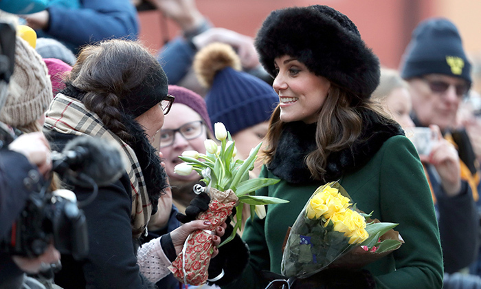 While walking to the Nobel Museum, the royal group met crowds of well-wishers, many of whom gave the pregnant Duchess bouquets of flowers.