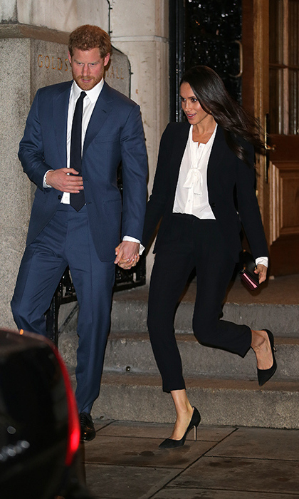 Meghan looked radiant in a black Alexander McQueen suit, a white blouse and sky-high Manolo Blahnik suede pumps. She and fiance Prince Harry held hands as they excited the Endeavour Fund Awards.