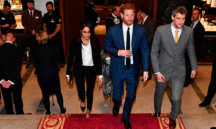 Fans were eager to see Prince Harry and Meghan step out for their first official red carpet and they didn't disappoint! The couple looked chic as they walked to their seats at Goldsmiths' Hall in London.
