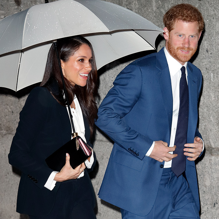 Meghan Markle carried an umbrella as she and Prince Harry arrived at their glitziest event yet, the Endeavour Fund Awards at London's Goldsmiths' Hall. While she looked gorgeous in an Alexander McQueen suit, he played it cool in a blue suit. 
