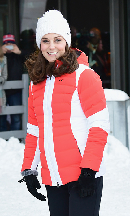 Kate was dressed to impress in fabulous red ski attire as she and William visisted the Holmenkollen ski jump. The glowing royal's quilted jacket was by KJUS Duana and she added a cute white Barts Jasmin Beanie which covered her curls.