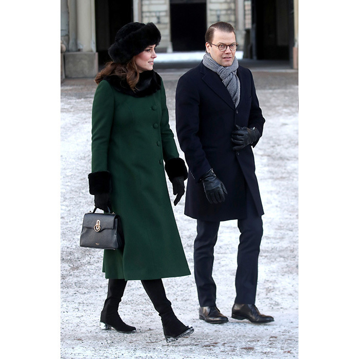 Kate strolled with Prince Daniel as they made their way from the Royal Palace of Stockholm to the Nobel Museum. Kate looked chic in a dark green Catherine Walker coat with black fur cuffs. She accessorized the look with a black fur hat and matching gloves, and completed the look with a black Mulberry bag.