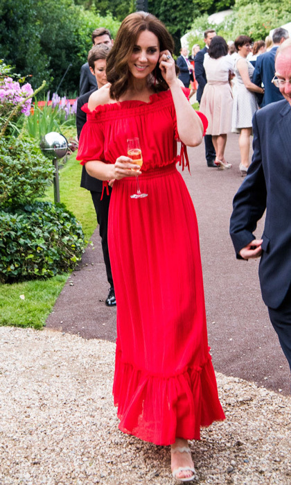 For a royal tour of Germany, the Duchess stepped out in a red Alexander McQueen dress for a garden party honoring Queen Elizabeth on July 19, 2017. The off-the-shoulder maxi dress features a cotton and silk-blend crinkled-chiffon frock from the designer's Spring 2017 collection.