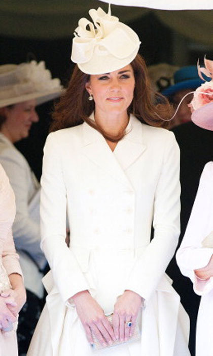 Kate opts for a shorter dress and Alexander McQueen coat with this look and pulls it off with a matching cocktail hat. She wore the coat just months earlier at another event.