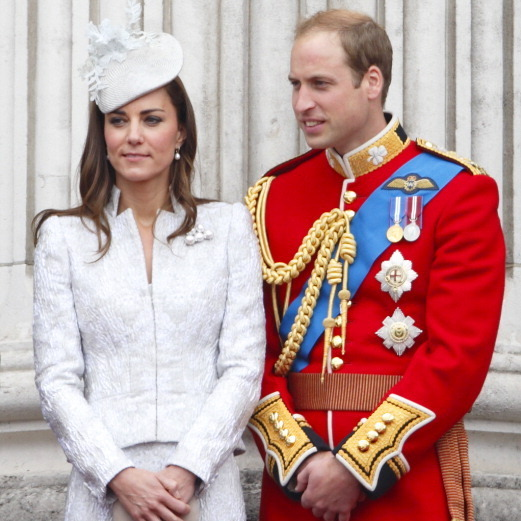 William and Kate make a stunning couple! Kate shines in her signature white, two-piece ensemble. 