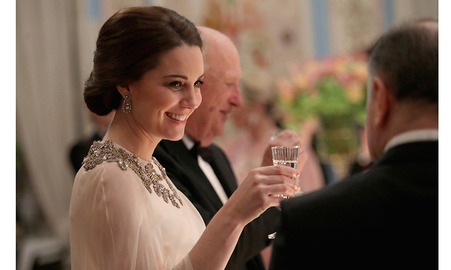 Cheers! Kate Middleton, wearing an embellished Alexander McQueen gown, takes part in the toast during the gala.