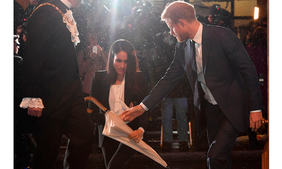 What a prince! Meghan Markle got a hand from fiancé Prince Harry, who took her wet umbrella as they arrived at the Endeavour Fund Awards on February 1 in rainy London.