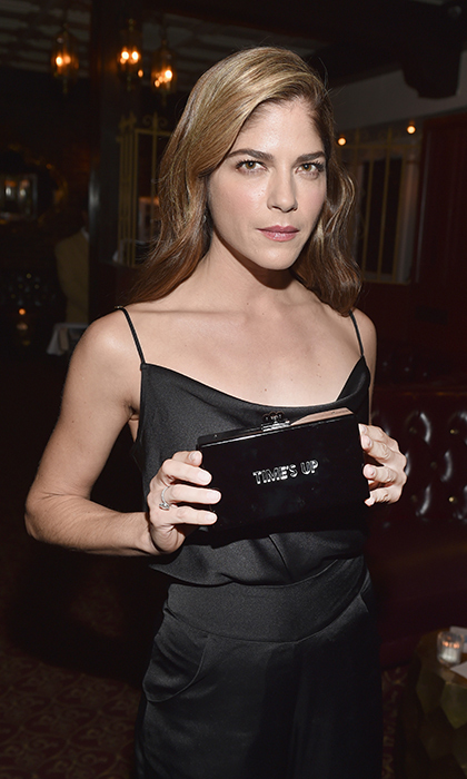 Time's Up! Selma Blair wore her politics on her box clutch while attending handbag designer Edie Parker's Beverly Hills fete at La Dolce Vita on Feb. 1.