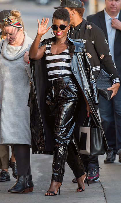 <em>Black Panther</em> star Lupita Nyong'o took a page out of her fierce character's fashion book wearing patent Balmain while arriving at Jimmy Kimmel Live on Feb. 2.