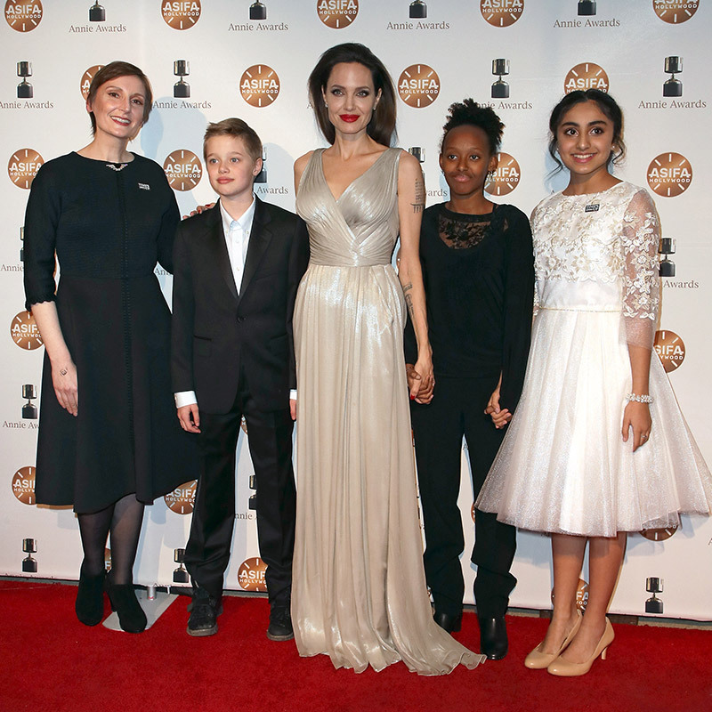 Angelina Jolie hit the red carpet at the Annie Awards with her daughters Shiloh Jolie-Pitt and Zahara Jolie Pitt, where they posed with director Nora Twomey and actress Saara Chaudry on Feb. 3 in LA.