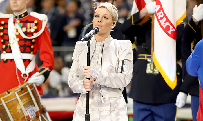 "The flu couldn't hold down this superstar! Pink stunned the crowd at the 52nd annual Super Bowl by belting out a gorgeous rendition of ""Star Spangled Banner."" 