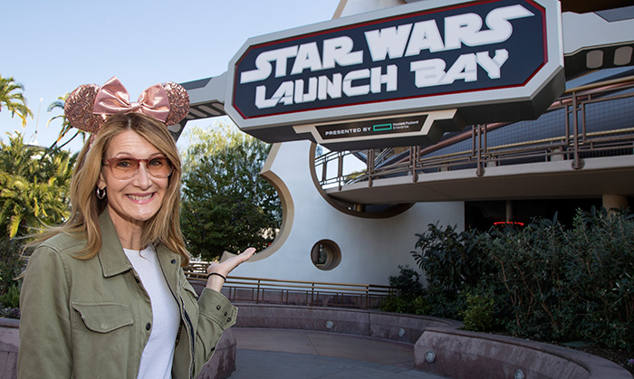 Laura Dern may play Vice Admiral Holdo in <em>Star Wars: The Last Jedi'</em>, but she also can't pass up a visit to Disneyland. She popped by the Star Wars Launch Bay on Feb. 3!