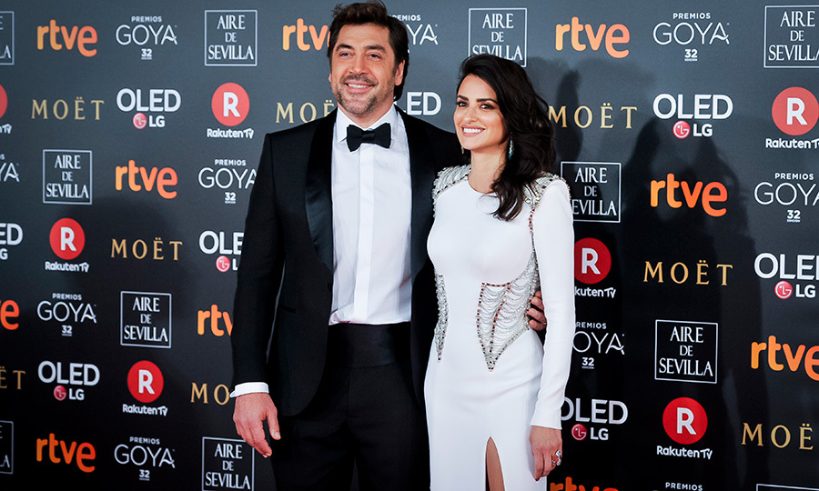 Penelope Cruz and Javier Bardem dazzled on the red carpet of the Goya Cinema Awards in Madrid on Feb. 3. The actress stunned in a caged, high-slit white gown, while her husband looked dapper in a handsome tuxedo.