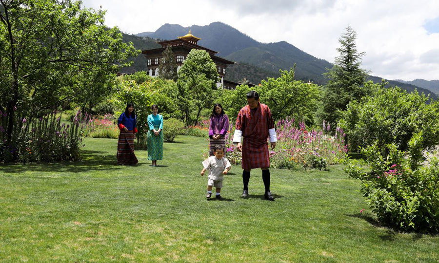 <p>Bhutan's Prince Jigme Namgyel Wangchuck showed off his latest milestone of walking for his parents and Princess Mako of Japan at the Tashichhodzong in June 2017. </p>