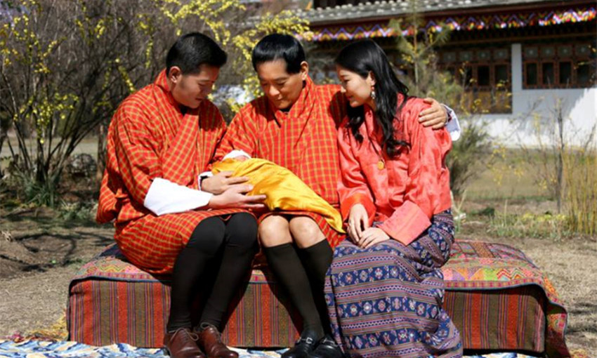 <p>The first photo of their new baby released by the royal couple featured proud grandpa His Majesty the Fourth Druk Gyalpo, who cradled the four-day old baby boy on his lap as he sat between the new parents.</p>