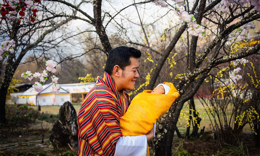 <p>King Jigme is the picture of happiness as he gazes at the little heir in this sweet snapshot. </p>
