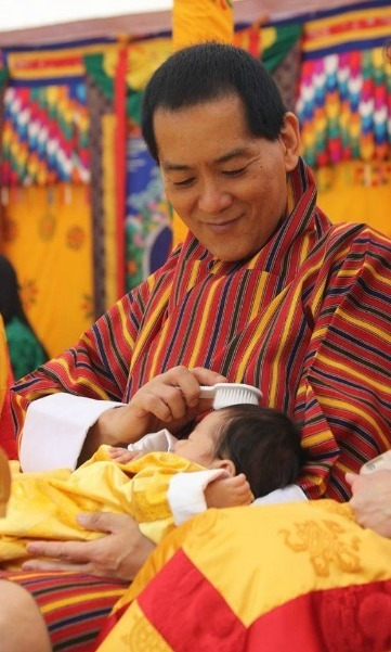<p>Jigme's grandfather gently brushes the little boy's hair in this sweet snap.</p>
